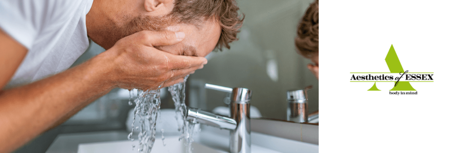 man washing his face to treat acne